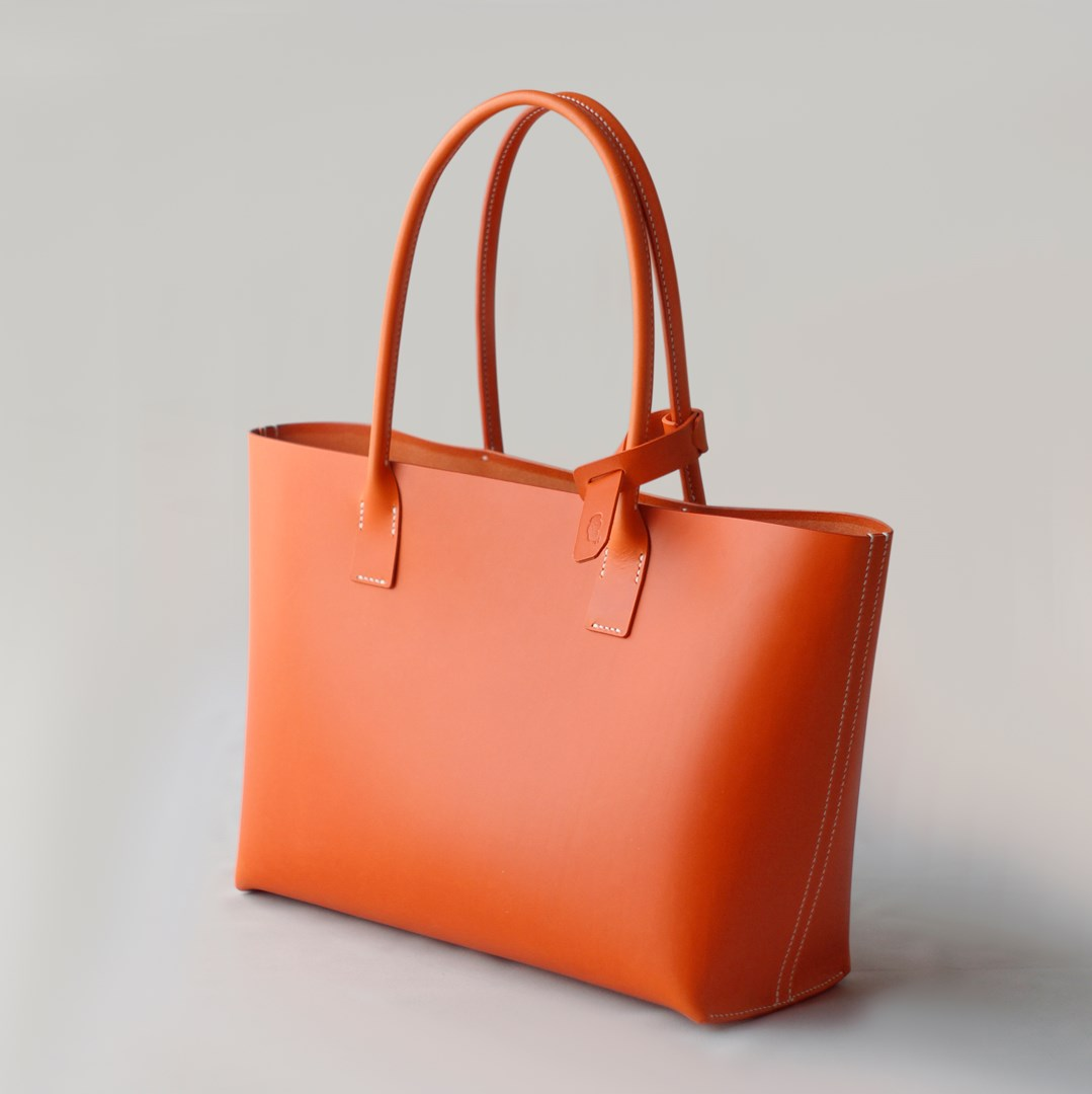 "kumosha hand stitched leather tote bag ""Orange"""