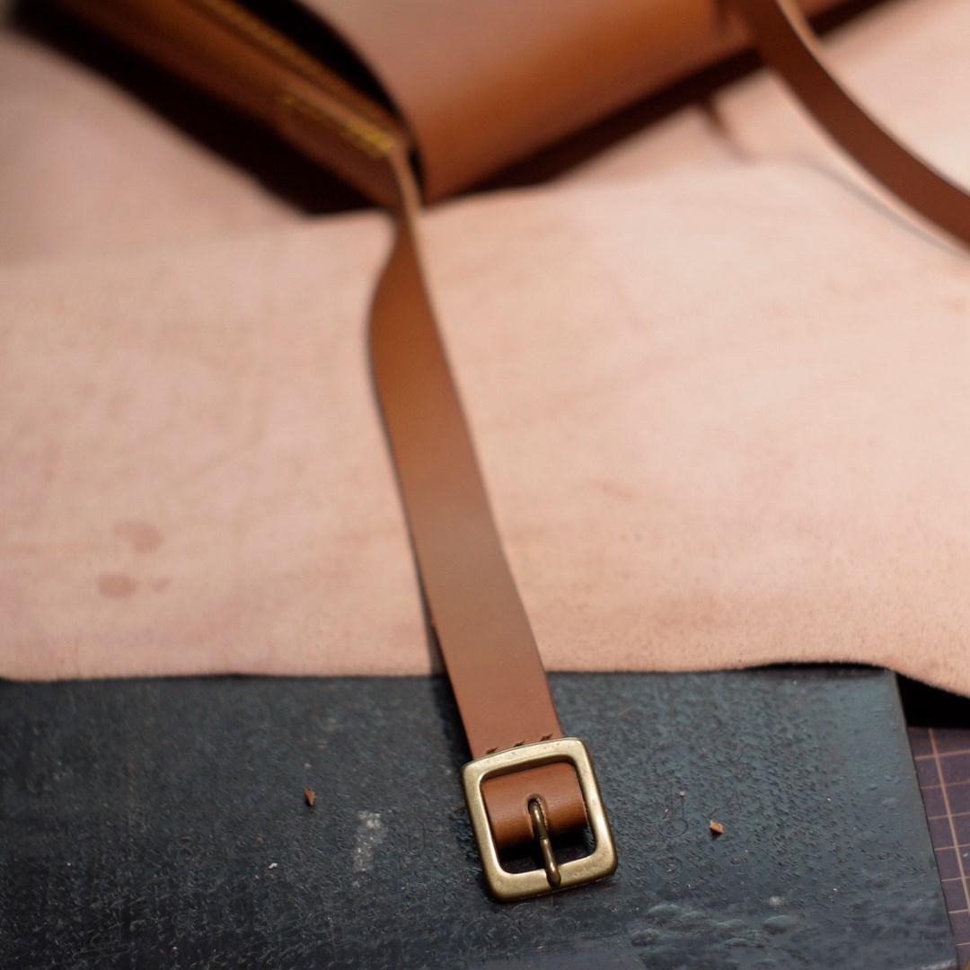 kumosha hand stitched leather shoulder bag Peter in Alps